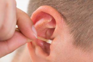 Cotton bud in ear
