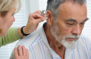 Fitting a hearing aid into the ear